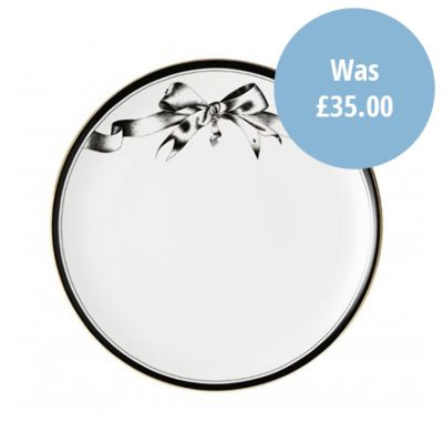 'Beware of the Wear Trap' black and white fine bone china dinner plate with illustrated bow design