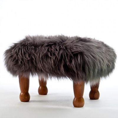 modern and luxurious sheepskin footstool