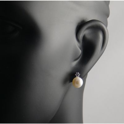 real pearl studs with diamante accents