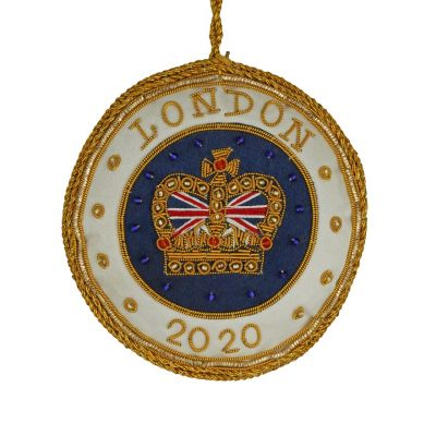 "London 2020 Christmas decoration - royal blue roundel embroidered with a gold crown with union jack and embellished with beads. Champagne satin border trimmed with gold and inscription ""London 2020""."
