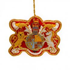 "St Nicolas Royal coat of arms tree decoration - Queen Anne crest surrounded by a garter bearing the motto Honi soit qui mal y pense ('Evil to him who evil thinks') and ""Semper Eadem"" {'Always the same'), supported by the Lion of England and the Unicorn of"