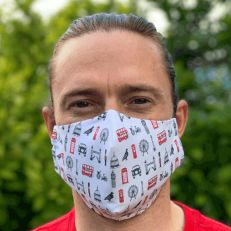 fitted cotton face mask displaying various London landmarks
